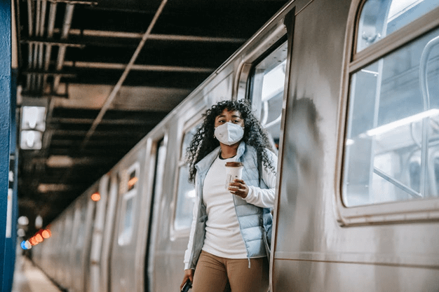 girl stepping out from train